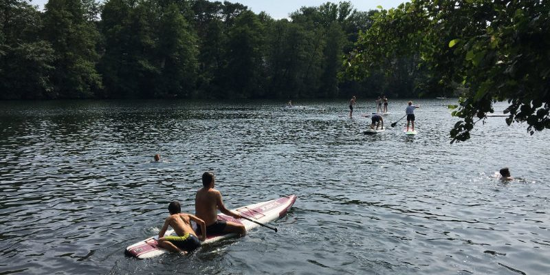 Stand up paddle boarding on the Schlachtensee Lake in Berlin